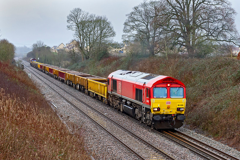 26th Jan 2020:  Running nearly 3 1/2 hours early  66020 TnT with 66129  are working 6W01 from Exeter St Thomas to Westbury is nearing Clink Road Junction.  Pictured from the footbridge in Styles Hill Lane in Frome.  Forunately the rain  eased just before I took the picture but was tipping down again before I completed the 30 yards walk to ge to my car.