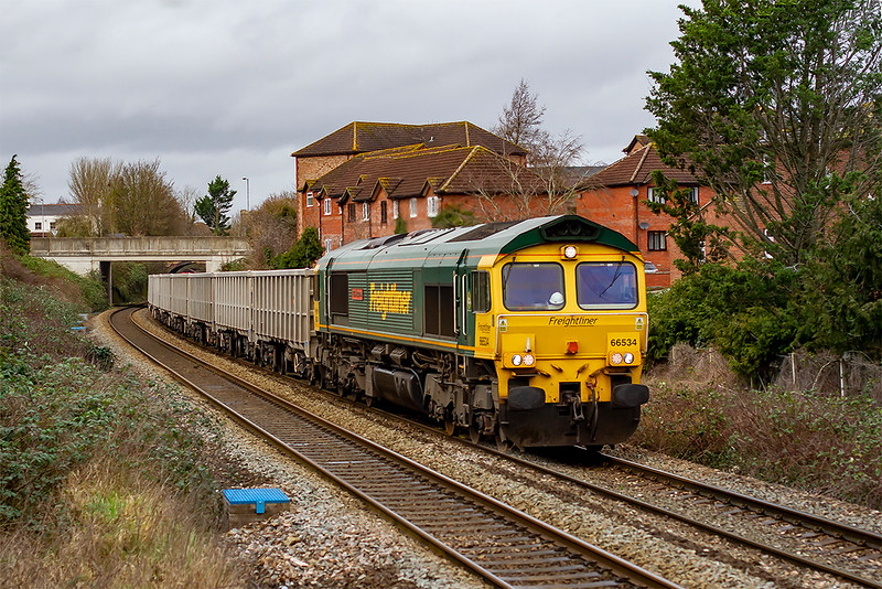 13th Jan 2020:  13  seconds after I pictured 66018 on the rear of 6C03 66534 on the point of 6C68 from Avonmouth to Whatley  Quarry passes the other way as it leaves Trowbridge.
