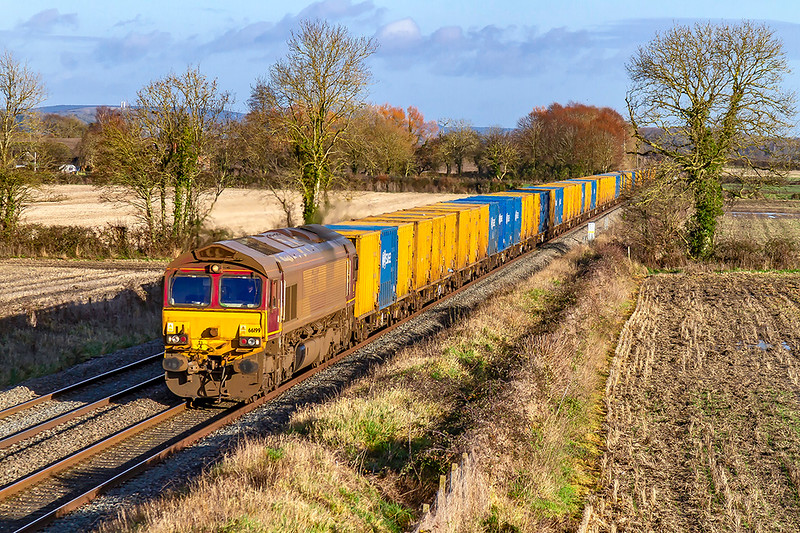 3rd Jan 2020:  At last the Pong Liner in the sun.  Today working from  Brentford to Severnside Sita powered by 66199 it is again captued at Edington.