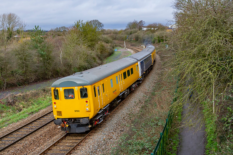 30th Fan 2020:  3Z01 is running to Westbury from Derby Derby R T C ,  DVT 9703  is leading  as it powers away from Bradford Junction.  Providing the urge is Colas 37116. The signal does actually lean at this angle.