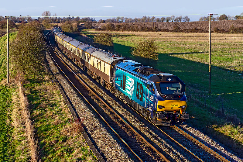 19th Jan 2019:  On a beautiful cold afternoon 68009 is pictured at the top of Upton Scudamore Bank as it works 5Z51 to Eastleigh.  The  train had started from Bristol Temple Meads with the stock  of the previous day's northerly tour to celebrate the end of the Class 20s