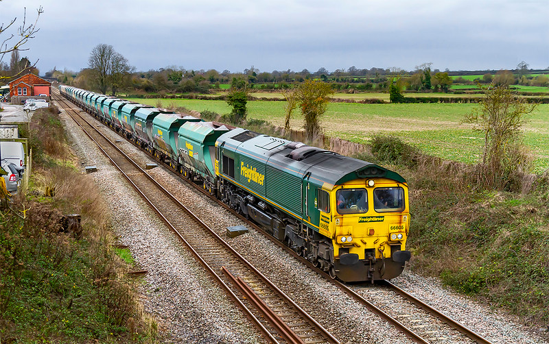 6th Jan 2020:  With a very rusty front end 66605 is providing the urge on 6Z50  pictured as it passes through the site of `Edington & Bratton  station that closed in 1954..  This working  has started from East Usk Yard at 05.28 and sprnt 2 1/2 hours in Bathampton Loop.  This allowed it to use the path of 6M20 (that  was not running) up the B & H line as it travelled to Hayes & Harlington Tarmac