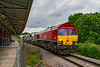 6th Jul 2020:  66107 working 3Z15 left Didcot Fueling Point on tine at 09.12 heading to Exeter Riverside.. Having cut out any planned stops it is 45 minutes early at this point and had to use the Down Loop as the booked route through Platform 2 was occupied. Fortunately the sun had vanished making this shot possible.  The MPVs are DR98906 & DR98956.