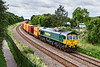 10th Jul 2020:  Pictured at Ladydown in Trowbridge is 66536 as it works 4V54 from Southampton Maritime to Avonmouth West Wharf.This runs on an occasional basis. All the containers always carry a label  'ATTENTION  -  BULK LIQUID  - Handle with Care' I wonder what it is.