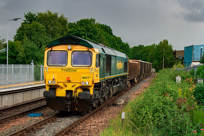 1st July 2020:    In the hands of 66512 7V62 the  13.21 fron Southampton Up Yard to Whatley Quarry started 13 minutes early.  At 14.46 it is stll 8 minutes early as it runs through Warminster.and the back of the train got some sunlight !