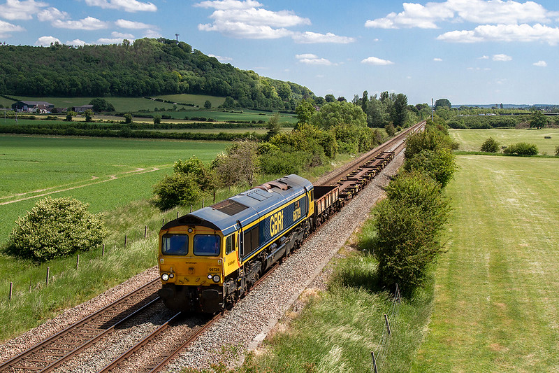 1st Jun 2020:  With Arn Hill in the background 66739 'Bluebell Line' is about to pass under the Warminster Bye Pass as it heads 6V44 to Kineton MOD from Marchwood MOD.  My first picture of this loco was in June 2004 at Battledown but then it was a Freightlner loco numbered 66579.