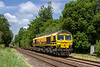 9th Jun 2020:  With ony 2 FRA wagons in tow 66413 'Lest We Forget' , with a rather faded orange paint, is captured passing through the village of Wylye. as it works 4O99 from Bristol Freightline Depot to Southampton MCT..  When the Severn Bridge toll charges were removed the cost of moving containers by road over the Rivern Severn changed dramatically so the Bristol depot was closed and every thing niw goes or comes from the Wentloog Depot in Cardiff.  Presumably  this was clearing the last  wagons from the Depot.