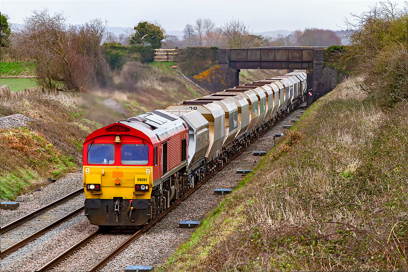 7th Mar 2020:    59201, with the 'Bell End' leading, is running through Edington  as it works 6C31 from Theale to Whatley Quarry.  No sun but at least ti was not raining !