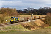 2nd Mar 2020:  Nearing Woodborough is 66418 in Power Haiul livery is in charge of 6C58 from Oxford Banbury Road to Whatley Quarry