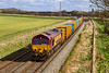 2nd Mar 2020:  66207 is again trusted with 6Bo3 the waste disposal service from Northolt to Sevrnside Sita.  The picture is taken  from the bridge at the East end of the site of Patney & Chirton station