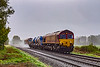 8th Oct 2020:  On a very wet and windy morning 66155 is leading on 3J13 running through Upton Lovell as it returns to St Blazey from Westbury via Salisbury.  66151 is getting even wetter on the other end.   Just a  bit of a record shot unfortunately and a post and cable ,behind the train, have been cloned from the view.