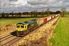 22nd Feb 2021:.  Running through Edington is 66416 bringing 6C58 from Oxford Banbury Road to Whatley Quarry.