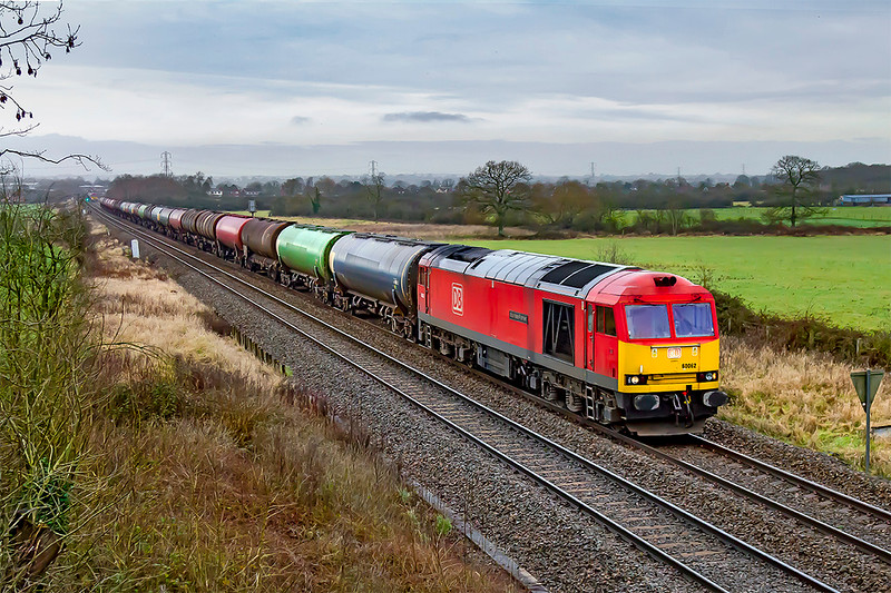 3rd Feb 2021:  The Robeston to Theale oil service started 15 minutes early but lost a lot of  time in West Wales.  The Freightmaster charts showed it running as 6Z11 with 60020 & 60062 'Stainless Pioneer doing the honours. so a picture could be worth the effort.  Pictured at Heywood the light was crap and 60020 was no where to be seen so this is the result.  Not really worth the effort.