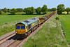 13th Jun 2021:  Leading on this leg of the 6X08 duty is 66951.  66561 is out of sight as it works  through Edington on it's way to Fairwater from Ruscombe that is just East of Twyford