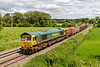 11th Jun 2021:  Passing through Great Cheverell onm the Berks & Hants line is 66616 on the point of 6C58 from Oxford Banbury Road to Whayley Quarry.