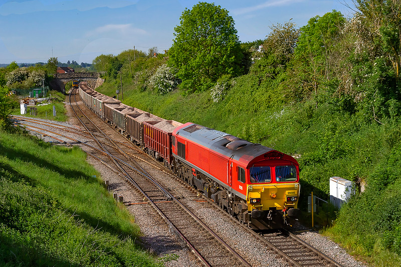 1st June 2021:  Crossing Hawkeridge  junction is 59205 'Keith I McNair' that is working 6A60 to Oxford Banbury Rd from Whatley Quarry..  With the line here  with a South West to North East allignemant getting a sun on the nose picture is quite limited