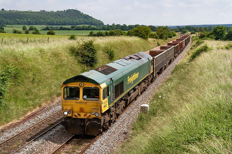 """1st July 2021:   66622 is at the head of 6V62 the 13.21 from Southampton Up Yard to Merehead. Quarry.  The bridge from which the picture is taken is called. 'Bear Close Cottage Overbridge"""" !!"""