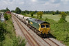 2nd Jul 2921:  Passing through the site of Edington and Bratton station is 66541  that is heading to St Pancras with 6M20 from Whatley Quarry.