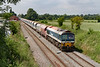 2nd Jul 2021:  7A17 in the hands of 59102 working from Merehead to Acton runs through the site of Edington & Bratton station  that was closed in the early 1950s.