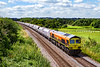 14th Jul 2021:   If this service had been in the hands of a green loco I would probably not bothered to take this picture  but as  59206. is in the G & Y Orange livery it shows up very well.  With 44 waggons in the consist 6L21 is working from Whatley Quarry ro Dagenhan Dock ARC.