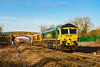 8th Mar 2021:  Double headed 4O57 from Wentloog and going to Southampton Maritime Container Terminal is pictured at Heywood near Westbury. The lead loco is 66537 and in case it  did not know that 66415 is tucked inside it is named 'You Are Not Alone'.