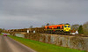 15th Mae 2021:  After a signal stop on the Westbury Avoider 59206  is powering away from Heywood Road Junction and up the Berks a & Hants line.  The working is tA09 from Merehead Quarry to Acton Yard.    About 2/3 rds of the train is visible.