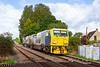 5th Oct 2021:  The Rail Head Treatment Train that coverrs the line between Salisbury and Warminster works out ans back from Effingham Junction in Surrey using an MPV.    DR98922 is leading on the return leg and is pictured five minutes after statting as it passes over the level crossing at Upton Lovell.