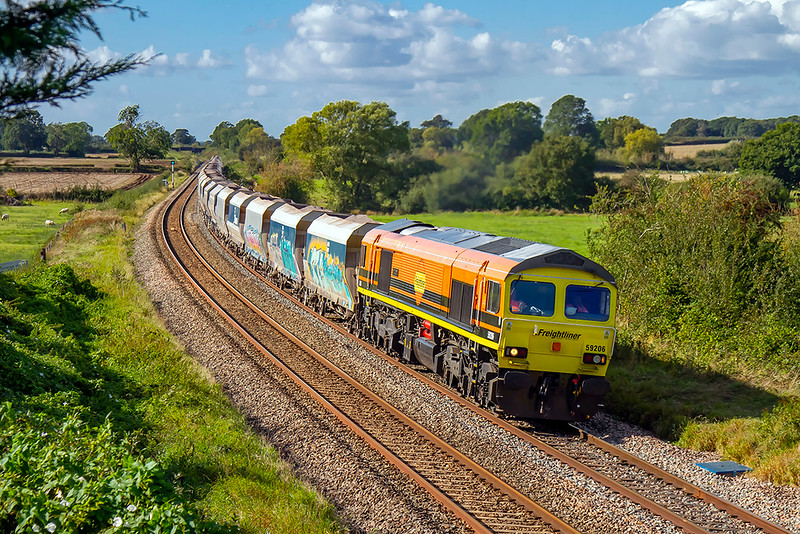 1st Oct 2021:  58206 starts the curve through Great Cheverell with 6L21 from Wahtley to Dagenham Dock.. rt  This is also the start of the almost continual climb up to Savernake..  I was here too picture tha Penzance to Victoria  kettles special  that was delayed at Westtbury meaning that I missed it as I could not wait there long enough.