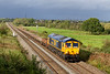 3rd Oct 2021:  In beautiful afternoon light at Heywood 66768 is passing as it woks 6G70 from Athelney to Westbury. via Taunton.  The black clouds make the perfect background..