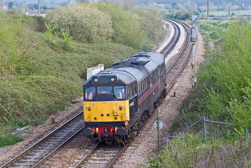 12th: Apr 07: 31452 pottering along to Eastleigh from Gloucester.  It was required to move some coaching stock to Southampton Docks for export.  It was to return later