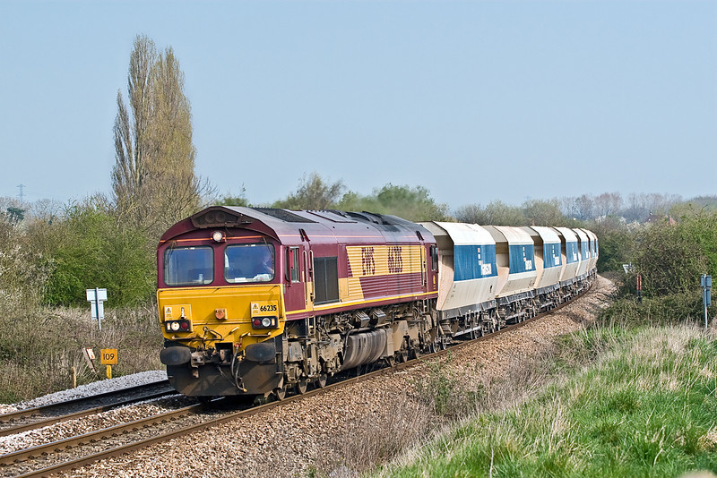 12th Apr 07:  'Shed and Stone' 66235 catches the sun as it returns empty hoppers from Wootton Bassett