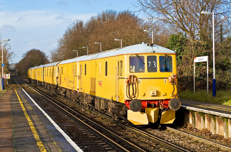 5th Dec 07:  73212 & 213 power through Addlestone as 5Z73 moving 4 GLV vans from Tonbridge to Eastleigh.  A large cloud moved away at just the right time !!