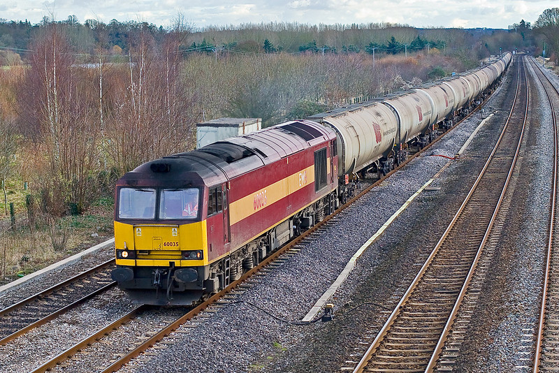 3rd Dec 07:  With tatty side numbers 60035 powers the 6E55 oil empties for Lindsey from Theale