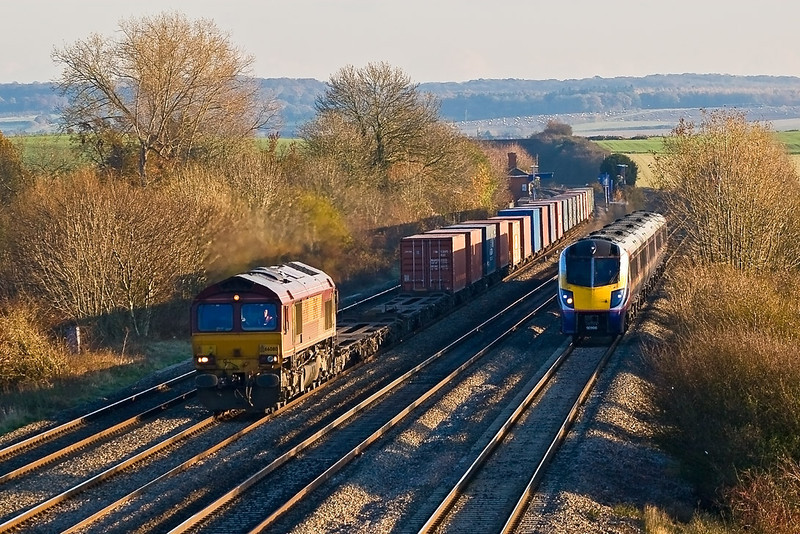 15th Nov 07:  66080 and the Southampton to Birch Coppice Intermodal is rapidly over taken by 180106
