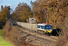 29th Nov 07:  59103 is caught in a welcome patch of sun as it winds the day's 6Z51 09.06 Acton Yard to Woking stone through Lyne