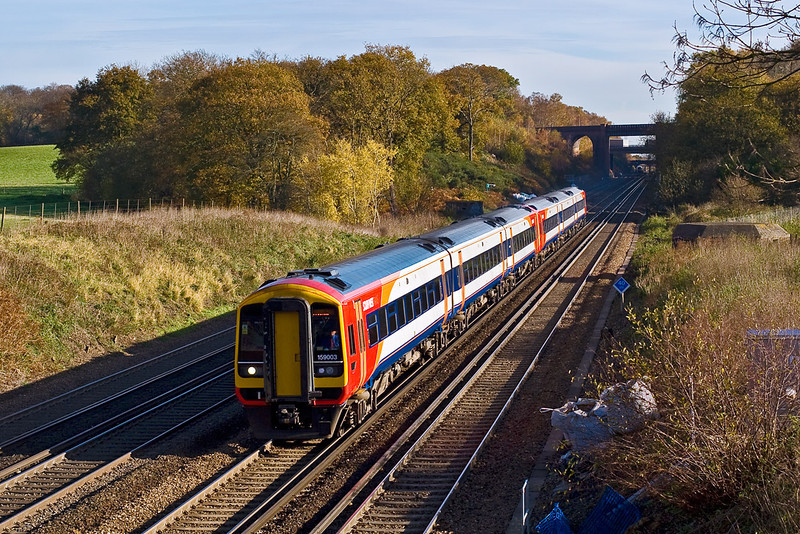 12th Nov 07:  Refurbished 159003 races West.  This view will shortly change for ever with the instalation of a new signal gantry