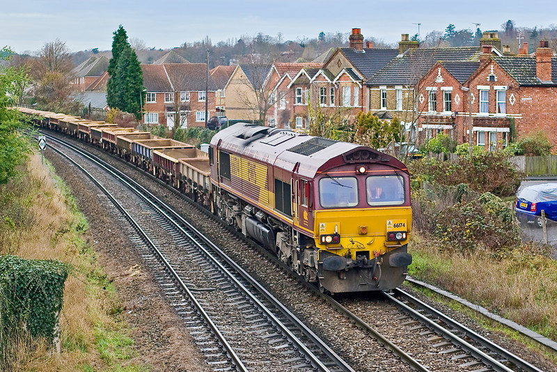 28th Nov 07:  On a very damp and dismal day 66174 trundles through Egham with the Eastleigh to Hoo Junction Departmental