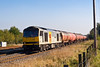 23rd Oct 07:  60056 on the 'Main' at Lower Basildon with the Theale to Robeston empty Murco oil tanks