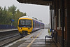 9th Oct 07  In torrential rain Turbo 165116 slows for the Tilehurst stop