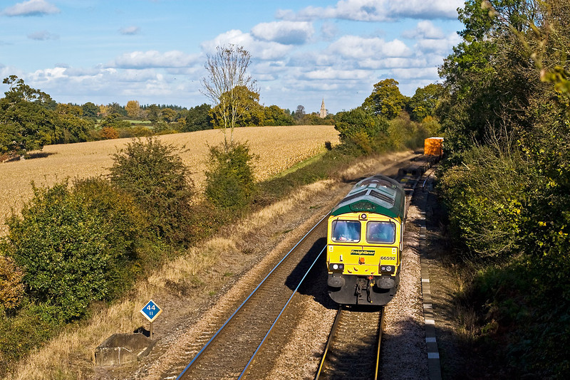 29th Oct 07:  In superb autumn light 66592 purs through Silchester.  Mortimer church can be seen in the distance.