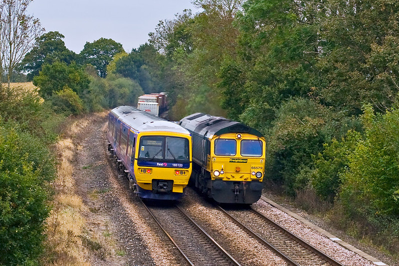 24th Oct 07:  165125 on the Basingstoke to Reading shuttle passes 66759 south bound at Silchester