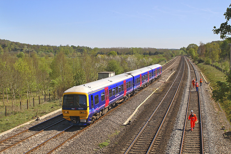 19th Apr 07:  166219 for Banbury passes track workers at Lower Basildon