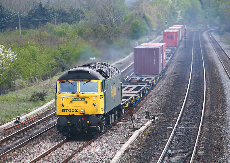 18th Apr 07:  57002 makes a fine sight as it hammers through Lower Basildon bound for Ditton