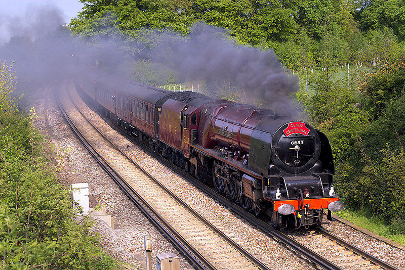 28th Apr 07:  Stanier  pacific 6233 heads the Terence Cuneo Centenary Special through Lyne.  Starting from Waterloo it was planned for the loco to go as far as Yeovil, however gauging issues required that the loco should not go beyond Salisbury.