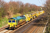 5th Apr 07:  66526 heads West with a consist of rail maintenance equipment