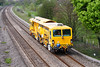 18th Apr 07:  Tamper 77903 passes on the up relief