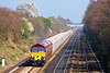 5th Apr 07:  59204 & 59205 head 7C77 empty stone fron Acton to Merehead.  Just visible under the distant signal gantry is the headlight of 66526 and the track machines