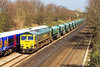 5th Apr 07:  66613 makes a welcome change from the usual diet of Class 59's as it works the Angerstein Wharf to Pengam emptiy JGA hoppers.