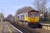 14th Feb 07:  66713 powers through Addlestone on 4Y19 empty Gypsum containers from Mountfield to Southampton