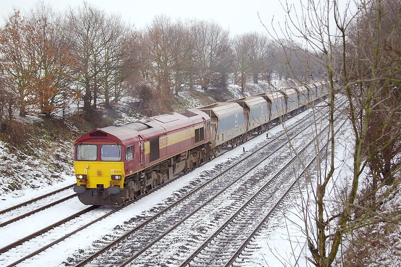 8th Feb 07:  25 years ago there were no trees on these embankments and it would have been possible to see all 45 waggons of 59205 hauling 7C77 Acton to Merehead jumbo empties.